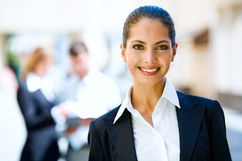 Professional Woman Standing and Smiling